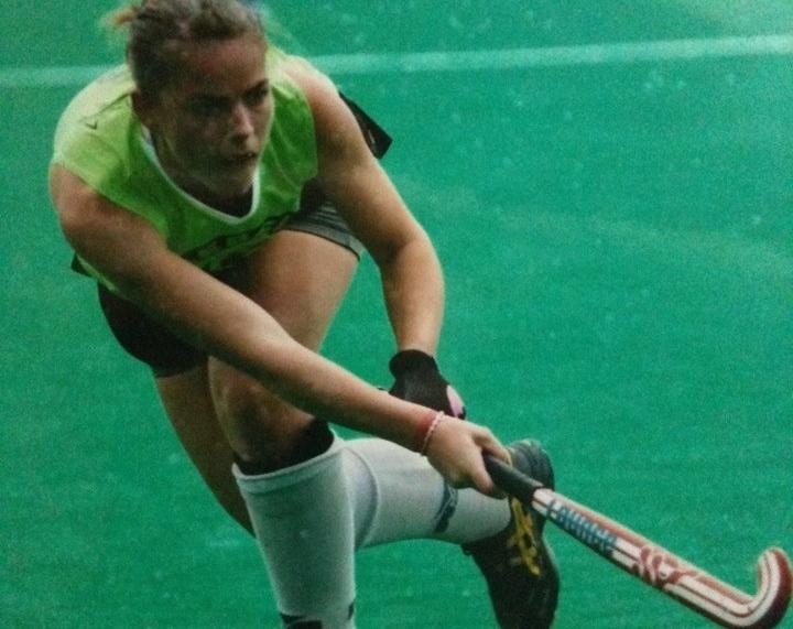 Emilie playing field hockey
