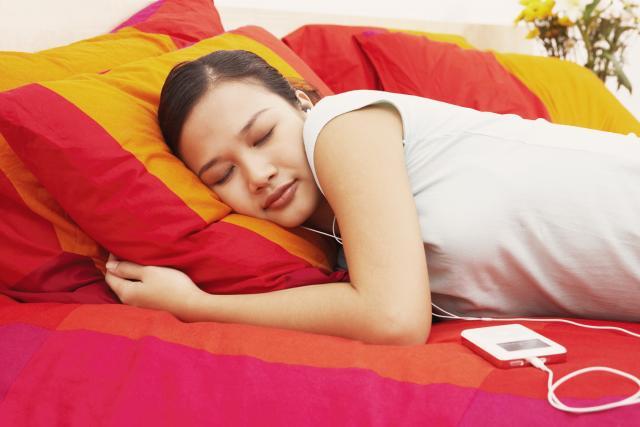 Woman falling asleep to peaceful music