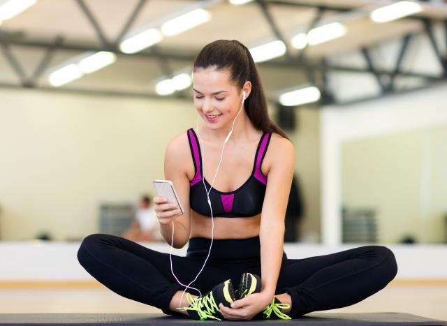 Woman in gym clothes on phone