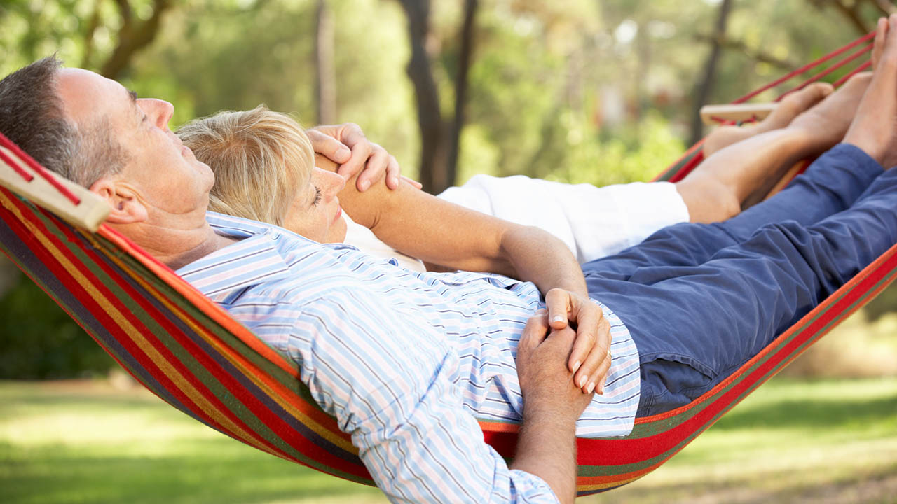 Couple relaxes in hammock