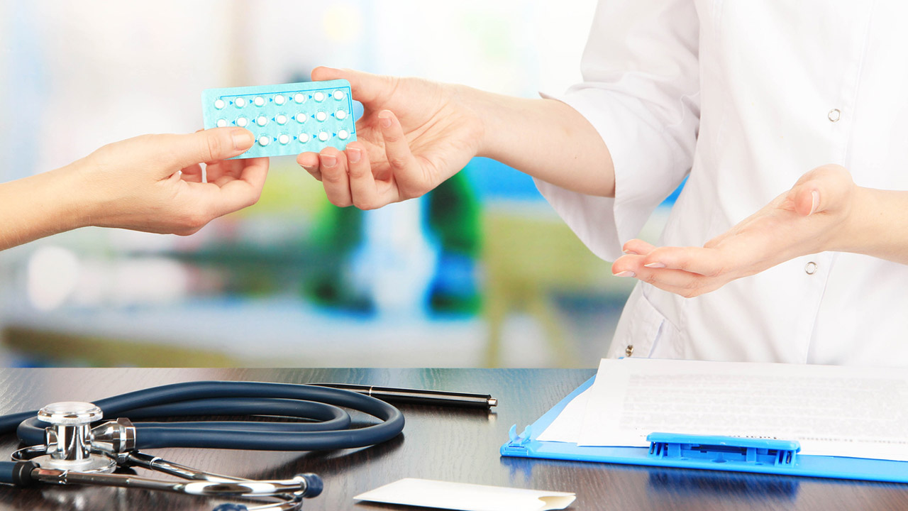 Doctor gives patient hormone therapy