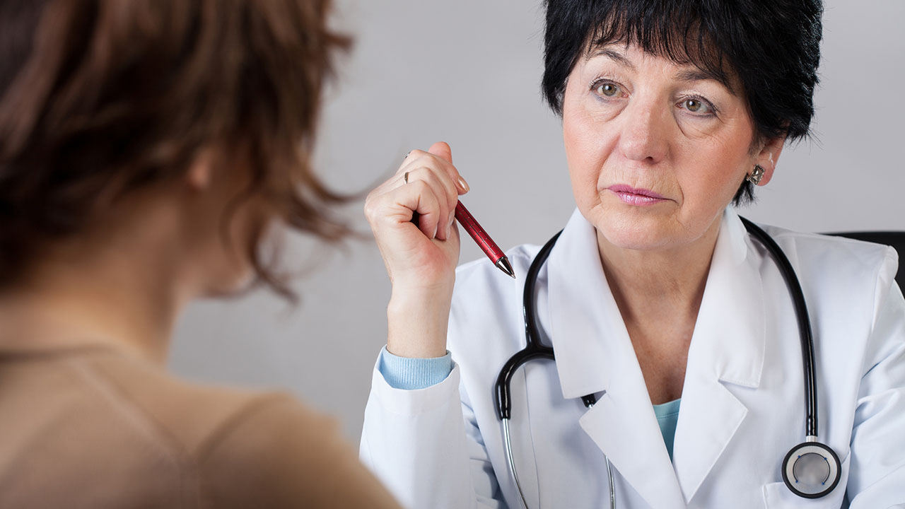 Female doctor speaks with patient