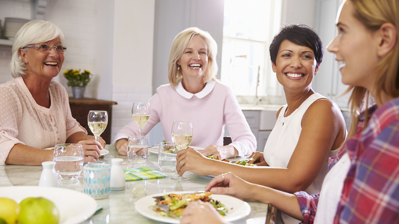 Group of women enjoying dinner together