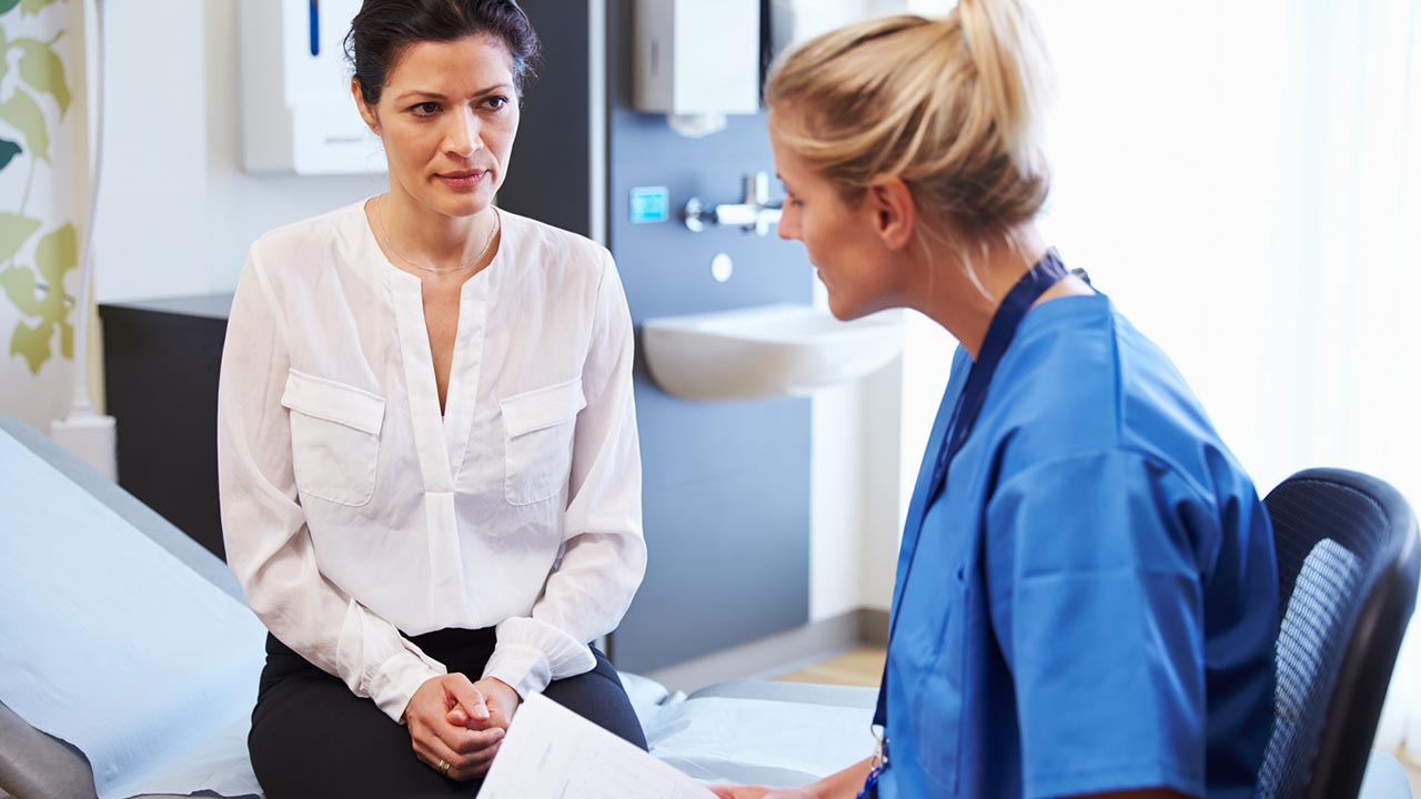Woman consults with her doctor
