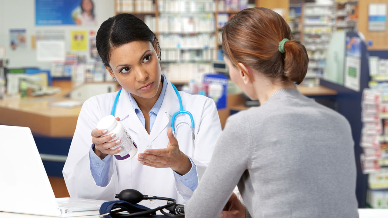 Doctor discusses medication with patient
