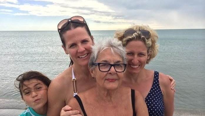 Maria D. with her grandchildren and great-grandchildren