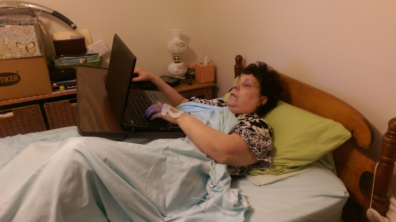 Michele working in bed