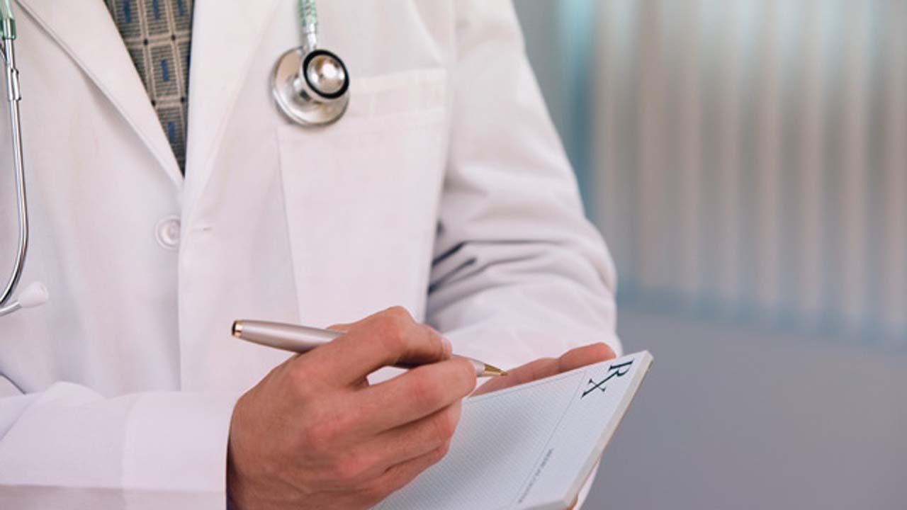 doctor prescribing biologics for psa