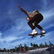 girl flying on skateboard