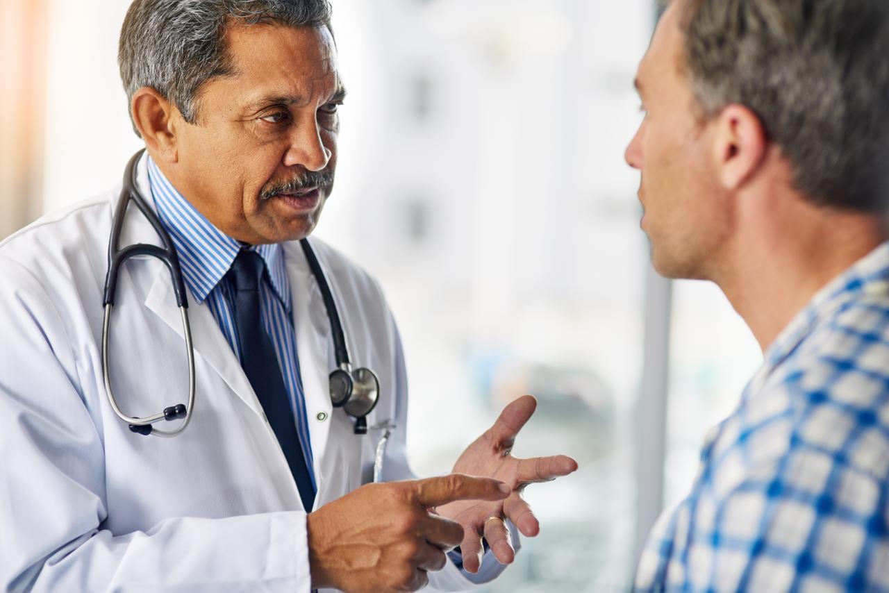 gastroenterologist talking to patient