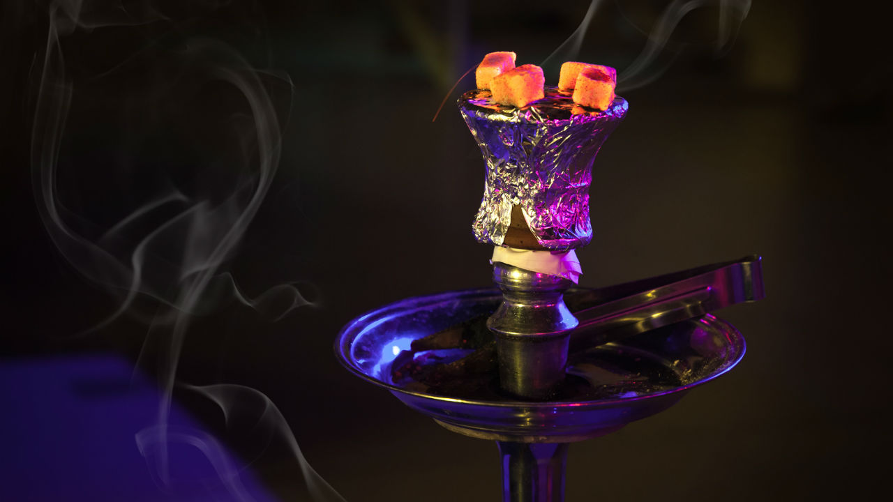 A hookah lounge (also called a shisha bar or den, especially in Britain and parts of Canada, or a hookah bar) is an establishment where patrons share shisha from a communal hookah or from one which is placed at each table or a bar.