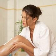 woman-moisturizing-skin