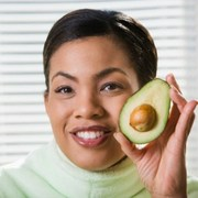 woman-enjoying-avocado-in-raw-diet