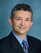Dr. Kam Raiszadeh